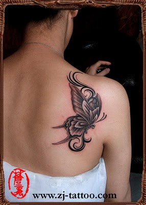 large and beautiful butterfly tattoo on girl's shoulder blade.