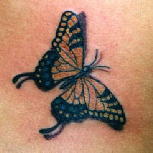 A simple and good look flying butterfly tattoo design.