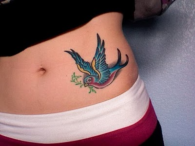 Colourful bird tattoos such as Swallows, bluebirds and parrots have