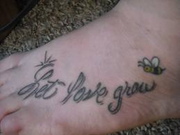 Cute bumble bee and words tattoo on foot.