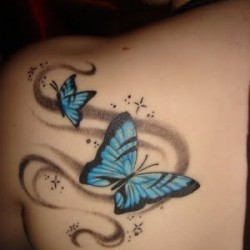 Two little blue butterflies tattoo on left shoulder blade.