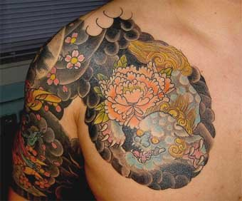 Foo dog tattoo on man's right chest and shoulder.