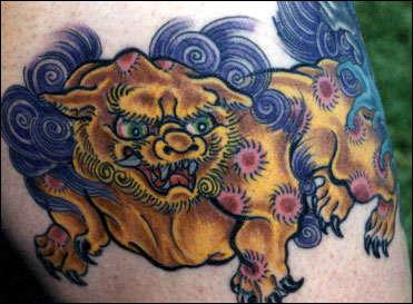 Watchdog tattoo also called Foo dog tattoo on man's arm.