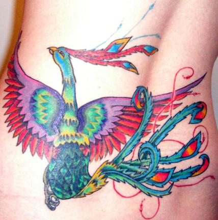 An amazing highly-coloured phoenix tattoo at lower back.