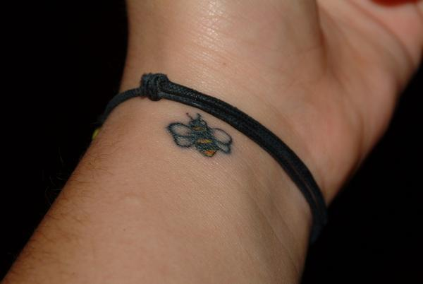 A cute and tiny bumble bee tattoo is very famous tattoo for girls especially