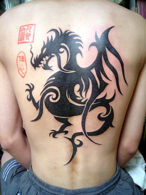 Large tribal dragon tattoo