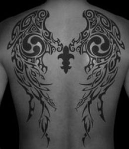 An awesome tribal angel wings tattoo design at back.