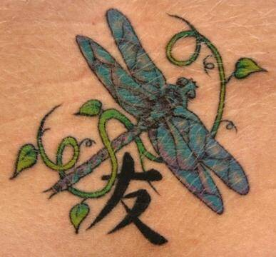 Flying dragonfly with Chinese word tattoo design.